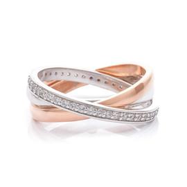 stříbrný prsten ze tří kroužků se zirkony